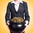 Woman holding pot of gold coins — Stock Photo #58250899