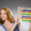 Young woman with abacus in school education concept — Stockfoto #58259591