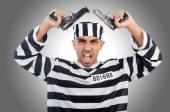 Prisoner with gun — Stock Photo