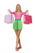 Woman with shopping bags isolated on white — Stock Photo