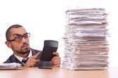 Angry businessman with stack of papers — Stock Photo