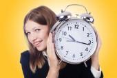 Obchodnice s hodinami — Stock fotografie