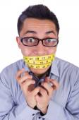 Man with centimeter in dieting concept — Stock fotografie