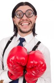 Funny young  businessman with boxing gloves isolated on white — Stock Photo