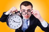 Businessman with clock — Stockfoto