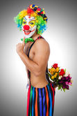 Clown with flowers — Stock Photo