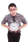 Man with clock trying to meet the deadline isolated on white — Stock Photo