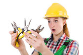 Construction worker female with pliers isolated on white — Stock Photo