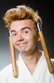 Funny karate fighter with nunchucks — Stock Photo