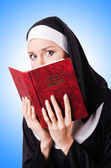 Young nun with a bible — Stock Photo