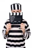 Funny prison inmate with movie board isolated on white — Stock Photo