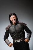 Angry warrior against dark background — Stock Photo