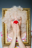 Funny clown with picture frame — Stock Photo