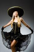 Woman wearing sombrero — Stock Photo