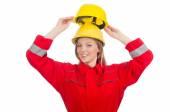 Woman in yellow helmet — Stock Photo