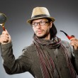 Funny detective with smoking pipe and magnifying glass — Stock Photo #60130505