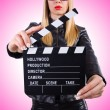 Woman with movie clapper on white — Stock Photo #60137997