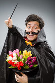 Funny magician man with wand and hat — ストック写真