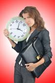 Businesswoman with clock — Stock Photo