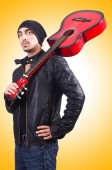 Man with red guitar — Stock Photo