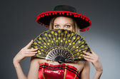 Woman dancing with fans in arts concept — Stock Photo