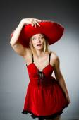 Woman wearing sombrero hat in funny concept — Stock Photo