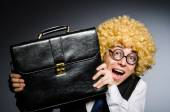 Funny businessman with curly hair — Stock Photo