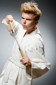 Funny karate fighter with nunchucks — Stockfoto