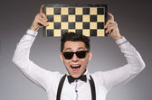 Funny chess player with board — Foto de Stock