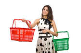 Woman with supermarkey basket isolated on white — Stock Photo