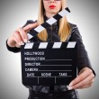 Woman with movie clapper — Stock Photo #65622491