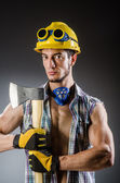 Ripped builder man with tools — Stock Photo