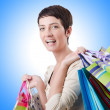 Girl after the shopping spree — Stock Photo #65641497