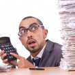 Angry businessman with stack of papers — Stock Photo #65642613
