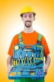 Repairman in coveralls in industrial — Stock Photo