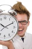 Funny doctor with alarm clock isolated on white — Stok fotoğraf
