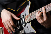 Man with guitar during concert — Stock Photo