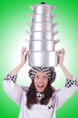 Cook with stack of pots on green — Stock Photo