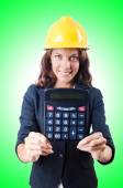 Female builder with calculator — Stock Photo