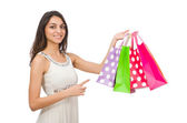 Woman with shopping bags isolated on white — Zdjęcie stockowe
