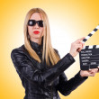 Woman with movie clapper — Stock Photo #67121757
