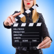 Woman with movie clapper — Stock Photo #67121765