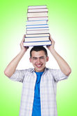 Uczeń z dużą ilością książek — Zdjęcie stockowe