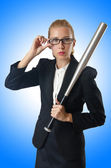 Businesswoman with baseball bat — Stock Photo