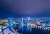 Skysrapers in Singapore during night — Stock Photo