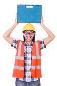 Komik genç inşaat işçisi üzerinde beyaz izole toolbox ile — Stok fotoğraf