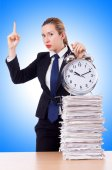 Businesswoman with huge clock — Stock Photo