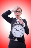 Businesswoman with giant clock — Stock Photo