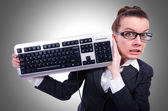 Nerd businessman with keyboard — Stock Photo