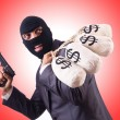 Gangster with bags of money — Stock Photo #69139685